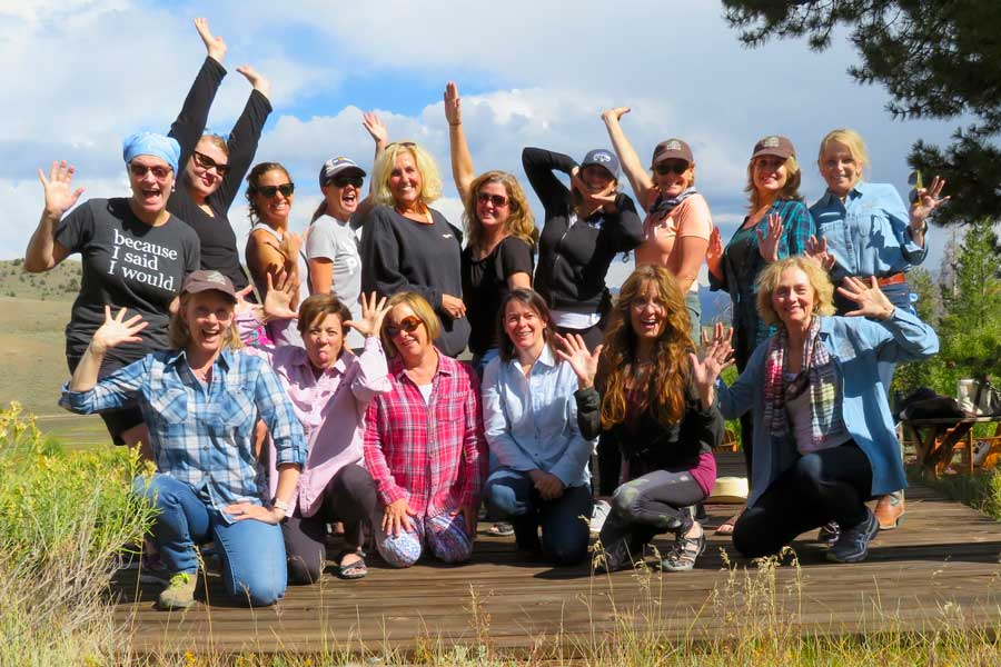 The women form a happy herd in our women's wellness retreat with horses